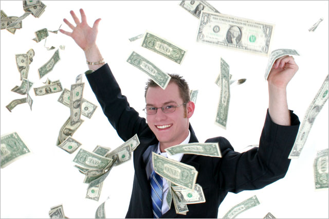 Attractive Business Man In Suit Throwing Money Into Air