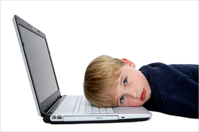 kid-head-on-laptop