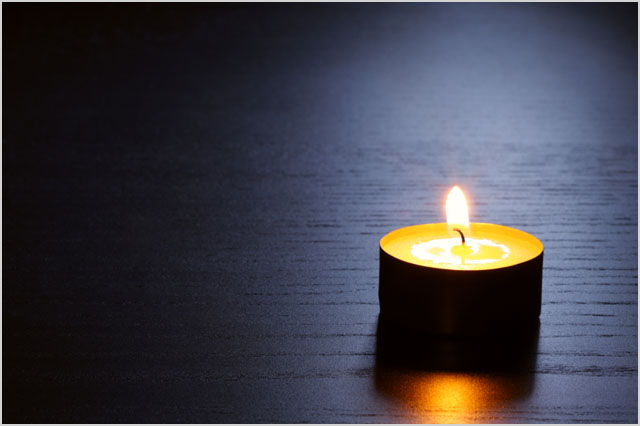 Single candle. Tranquil scene.